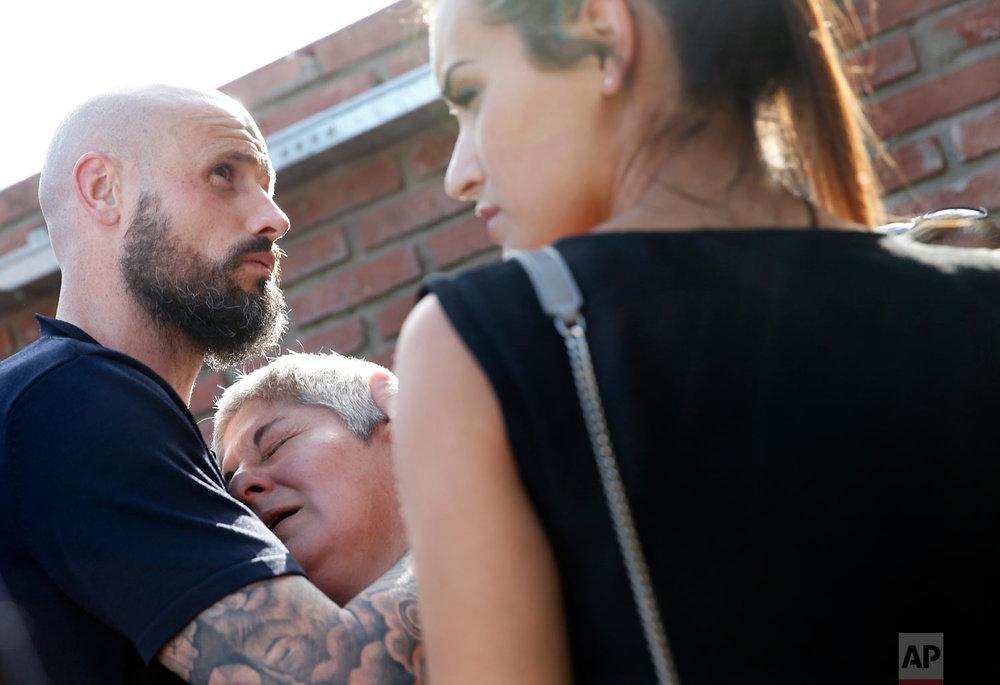 Mercedes Taffarel, mother of Argentine soccer player Emiliano Sala, is comfort by Nantes defender Nicolas Pallois during Sala's burial service at the cemetery in Santa Fe, Argentina, Feb. 16, 2019. (AP Photo/Natacha Pisarenko)