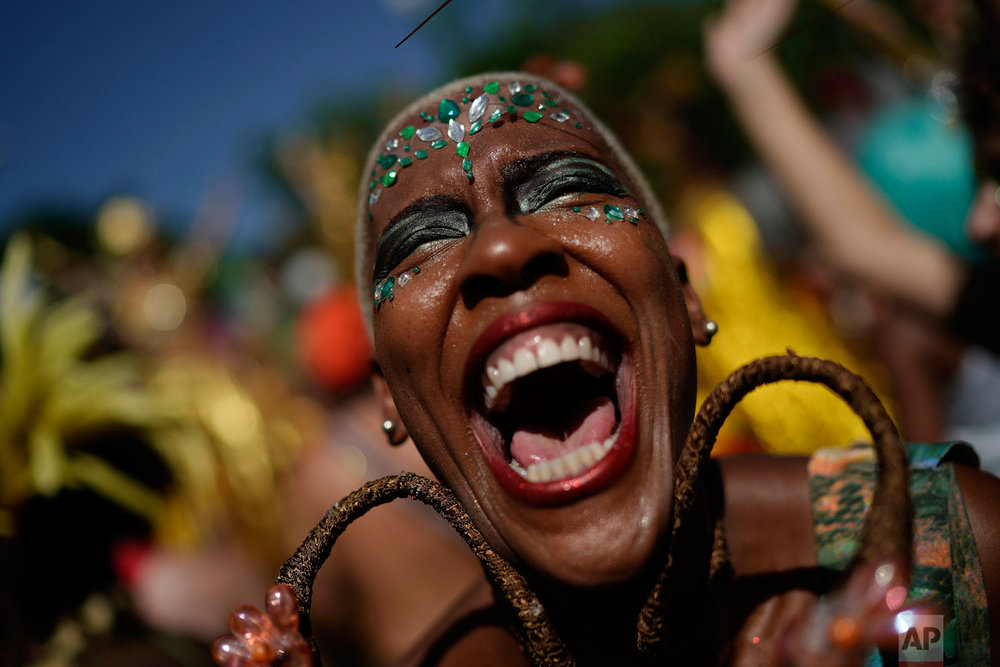 """A reveler in costume laughs during the """"Cordao do Boitata"""" street party in Rio de Janeiro, Brazil,  Feb. 24, 2019, one of the many parades before the official start of Carnival on March 1. (AP Photo/Leo Correa)"""