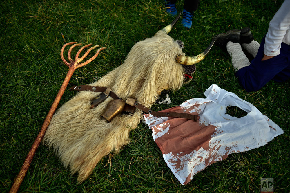 """A typical carnival dress known as a """"Momotxorro'' lies on the ground, in Alsasua, northern Spain, Tuesday, March 5, 2019. (AP Photo/Alvaro Barrientos)"""