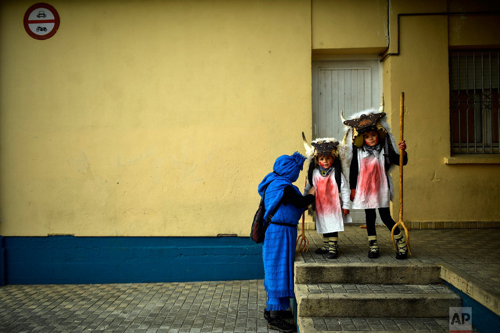 """Young """"Momotxorros """" prepare to take part in the carnival wearing typical carnival dress, in Alsasua, northern Spain, Tuesday, March 5, 2019. (AP Photo/Alvaro Barrientos)"""