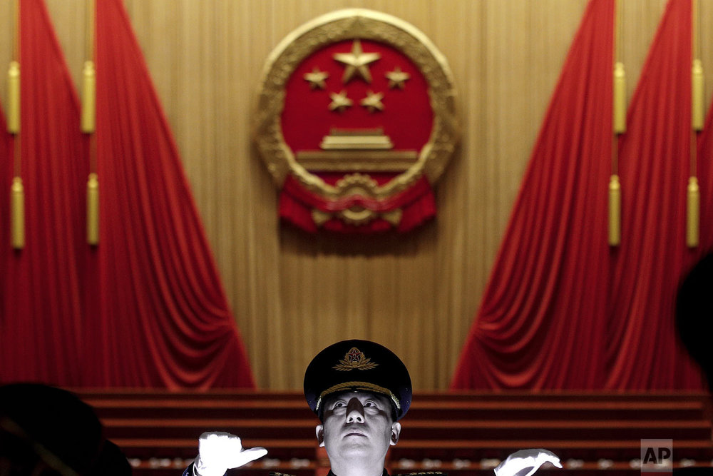 A military conductor leads band members during a rehearsal for the opening session of the China's National People's Congress at the Great Hall of the People in Beijing, Tuesday, March 5, 2019. (AP Photo/Andy Wong)
