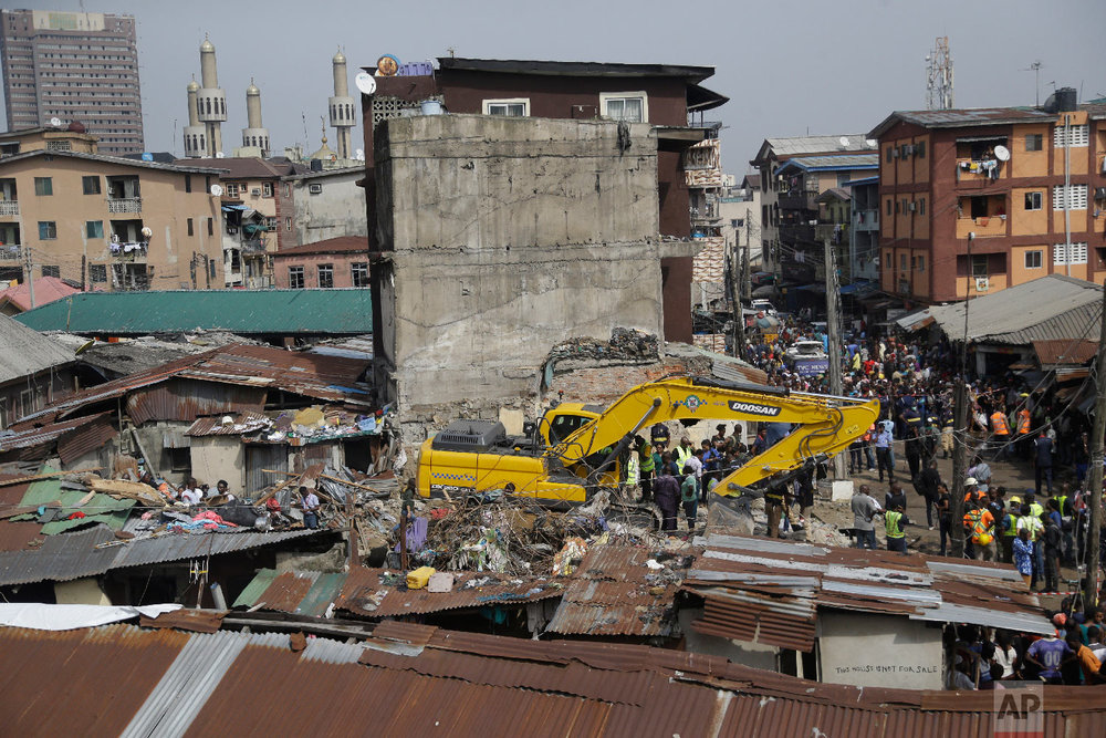 Emergency workers attend the scene of a collapsed building in Lagos, Nigeria, Thursday March 14, 2019. (AP Photo/Sunday Alamba)