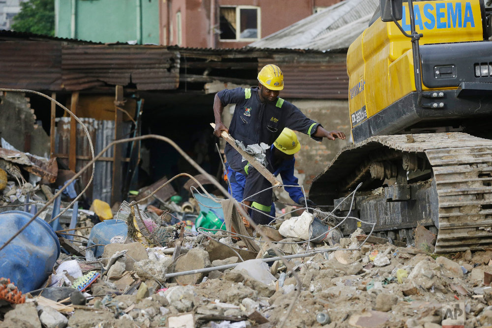 Emergency workers attend the scene after a building collapsed in Lagos, Nigeria, Thursday, March 14, 2019. (AP Photo/Sunday Alamba)
