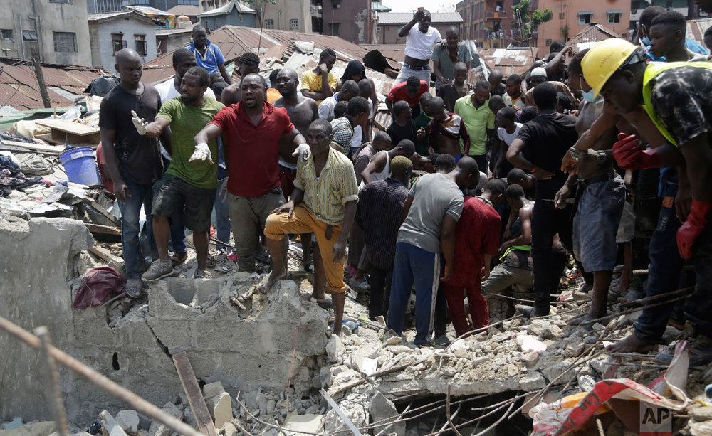 Emergency services attend the scene after a school building collapsed in Lagos, Nigeria, Wednesday, March 13, 2019. (AP Photo/Sunday Alamba)