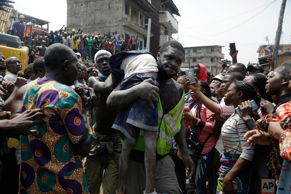 A body of a child is recovered from the rubble of a collapsed building in Lagos, Nigeria, Wednesday, March 13, 2019. (AP Photo/Sunday Alamba)
