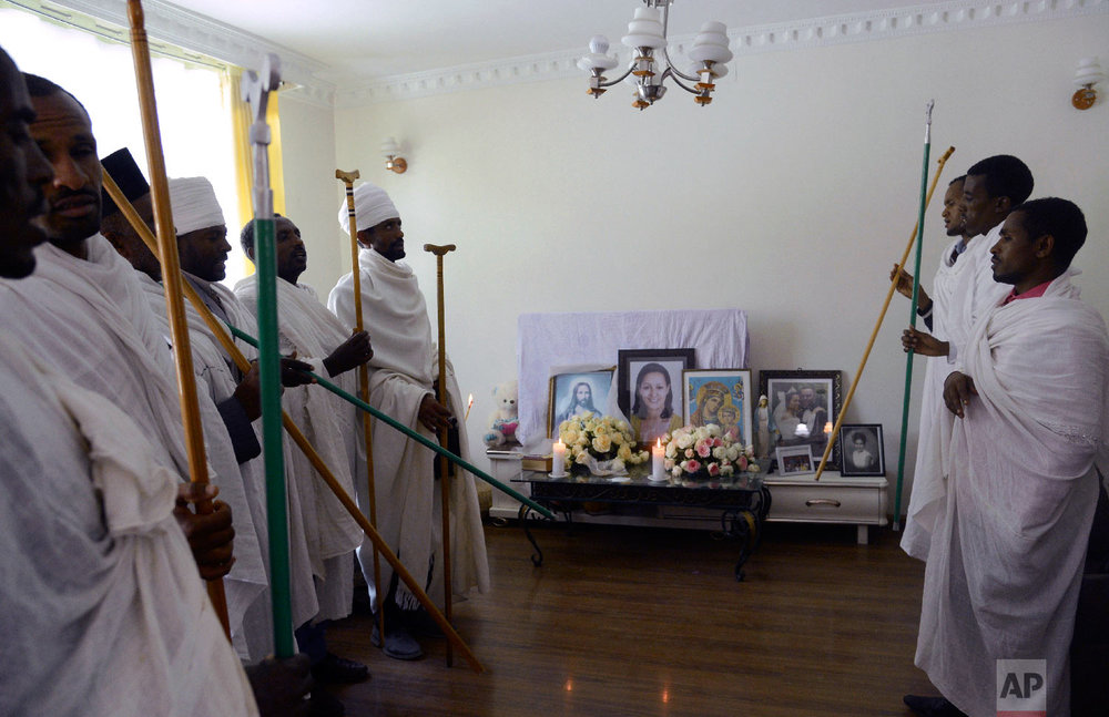 Ethiopian religious leaders pray at the house of crash victim air hostess Sara Gebremichael, 38, in Addis Ababa, Ethiopia, March 13, 2019. (AP Photo/Samuel Habtab)