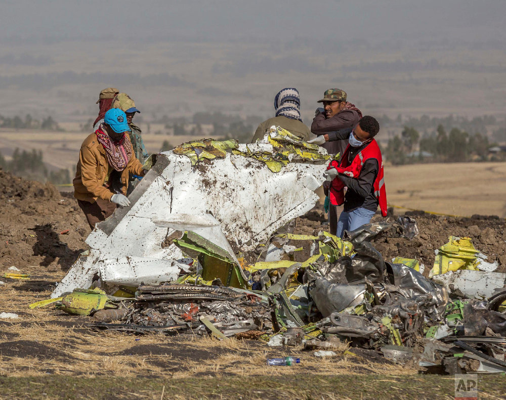 Rescuers work at the scene of an Ethiopian Airlines flight crash near Bishoftu, Ethiopia, March 11, 2019. (AP Photo/Mulugeta Ayene)