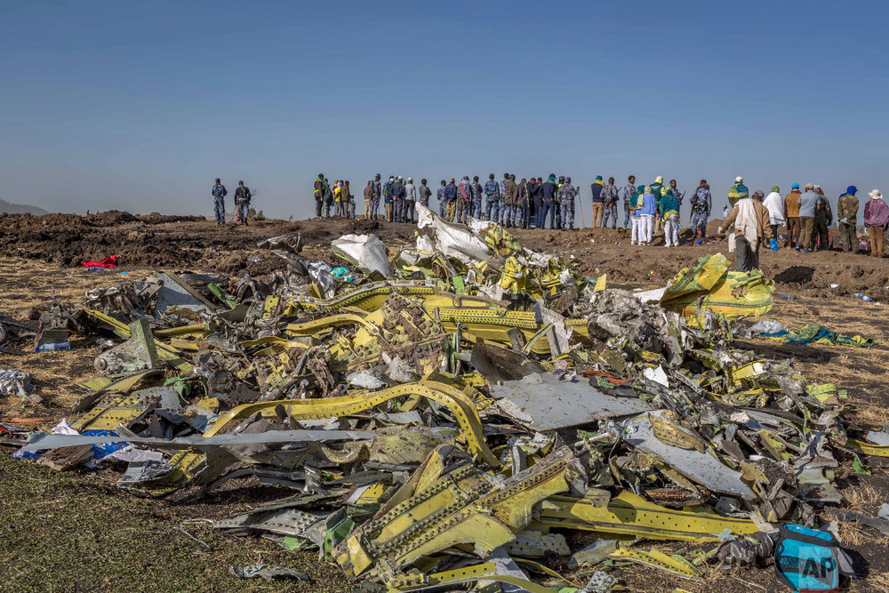 Wreckage is piled at the crash scene of an Ethiopian Airlines flight crash near Bishoftu, Ethiopia, March 11, 2019. (AP Photo/Mulugeta Ayene)