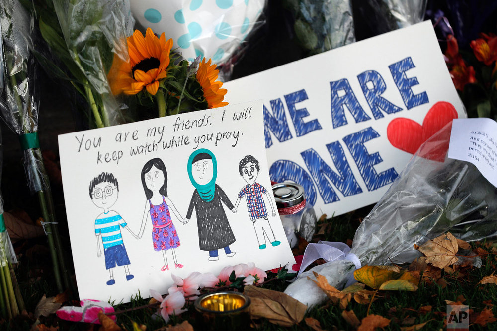 A message card is placed at a collection of flowers left at the Botanical Gardens in Christchurch, New Zealand, Saturday, March 16, 2019. (AP Photo/Vincent Thian)