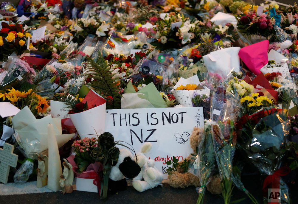 Mourners place flowers as they pay their respects at a makeshift memorial near the Masjid Al Noor mosque in Christchurch, New Zealand, Saturday, March 16, 2019. (AP Photo/Vincent Yu)