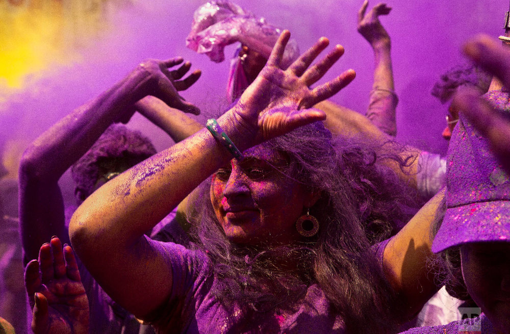 Indians dance during celebrations marking Holi, the festival of colors, in Gauhati, India, Thursday, March 21, 2019. (AP Photo/Anupam Nath)