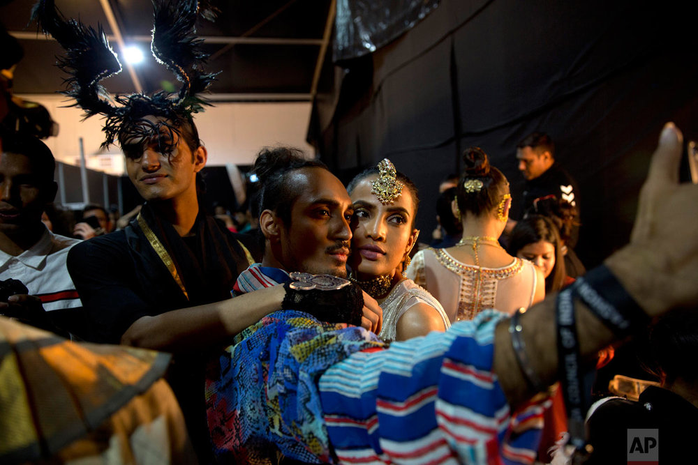 A designer and a model take a selfie backstage of the Lotus Makeup India Fashion Week, Saturday, March 16, 2019, in New Delhi, India. (AP Photo/Manish Swarup)