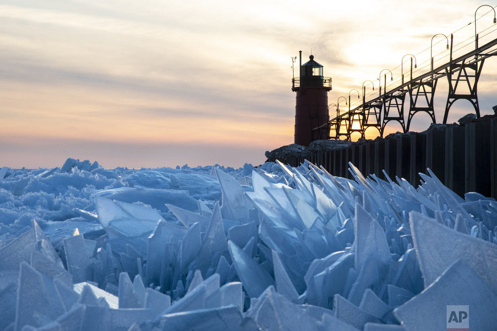 Shards of ice pile up on Lake Michigan along the South Haven Pier in South Haven, Mich., on Tuesday, March 19, 2019. The motion of the water underneath the ice has pushed up sheets of ice into a mesmerizing stacked pattern. (Joel Bissell/Kalamazoo Gazette - MLive.com via AP)