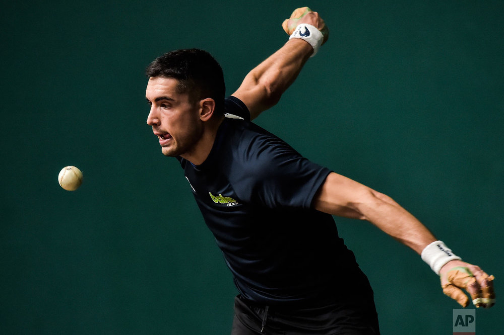 Victor Esteban, 25, a player of Basque Ball, warms up at Labrit court or fronton, in Pamplona, northern Spain on Feb. 28, 2019. (AP Photo/Alvaro Barrientos)