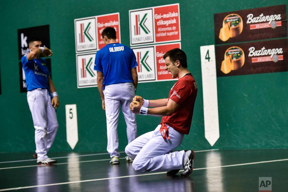 Danel Elezkano, right, celebrates winning the match 22-10 in Pamplona, Spain on March 9, 2019. (AP Photo/Alvaro Barrientos)