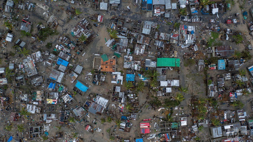 Seen from a drone Praia Nova Village, one of the most affected neighborhoods in Beira, razed by the passing cyclone, in the coastal city of Beira, Mozambique, Sunday March 17, 2019. (Josh Estey/CARE via AP)
