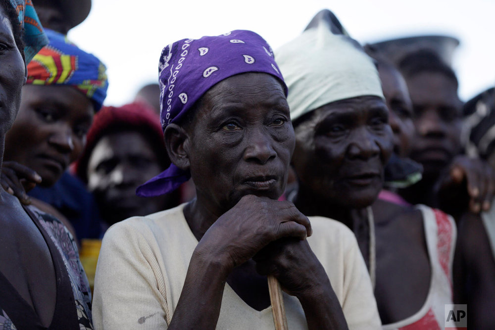 An elderly woman stands in a queue to receive food from World Food Programme in Nhamatanda, about 100km west of Beira, Mozambique, Thursday, March 21, 2019. (AP Photo/Themba Hadebe)