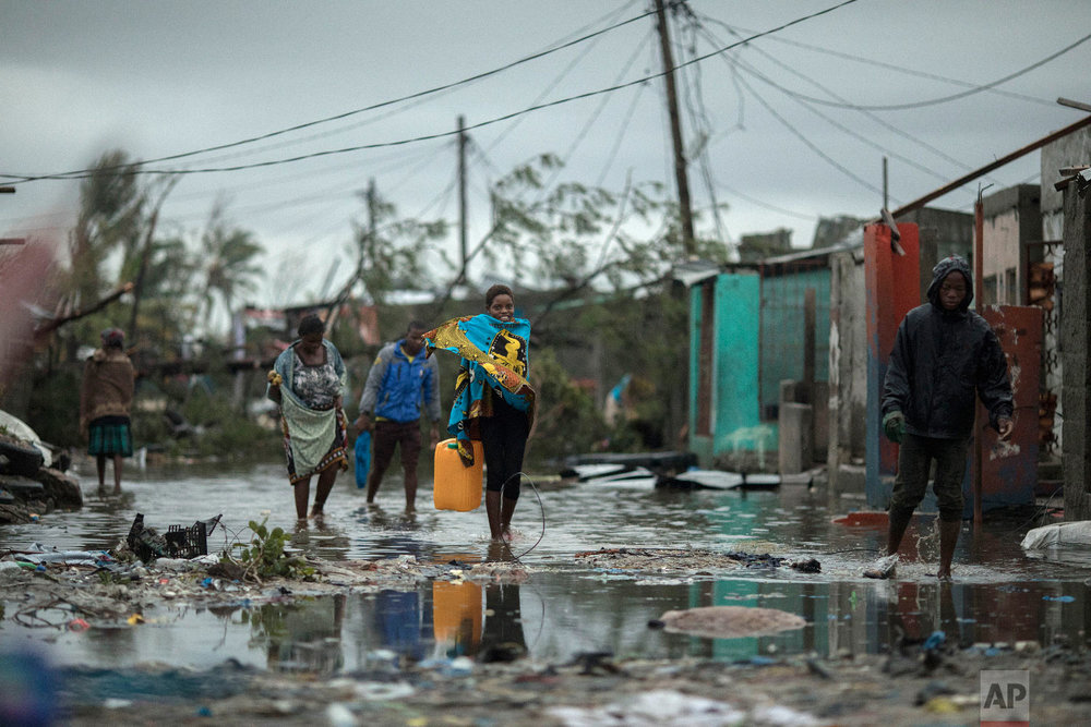 People return to Praia Nova Village, one of the most affected neighborhoods following a cyclone in the coastal city of Beira, Mozambique, Sunday March 17, 2019. (Josh Estey/CARE via AP)