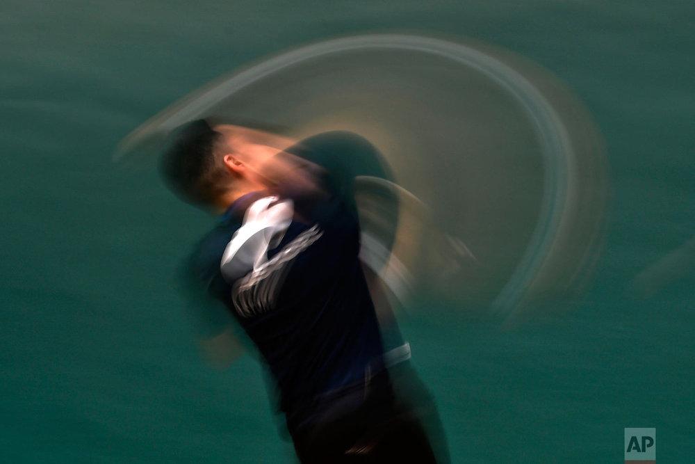 Victor Esteban returns the ball on a Labrit court or fronton, in Pamplona, Spain on Feb. 28, 2019. (AP Photo/Alvaro Barrientos)