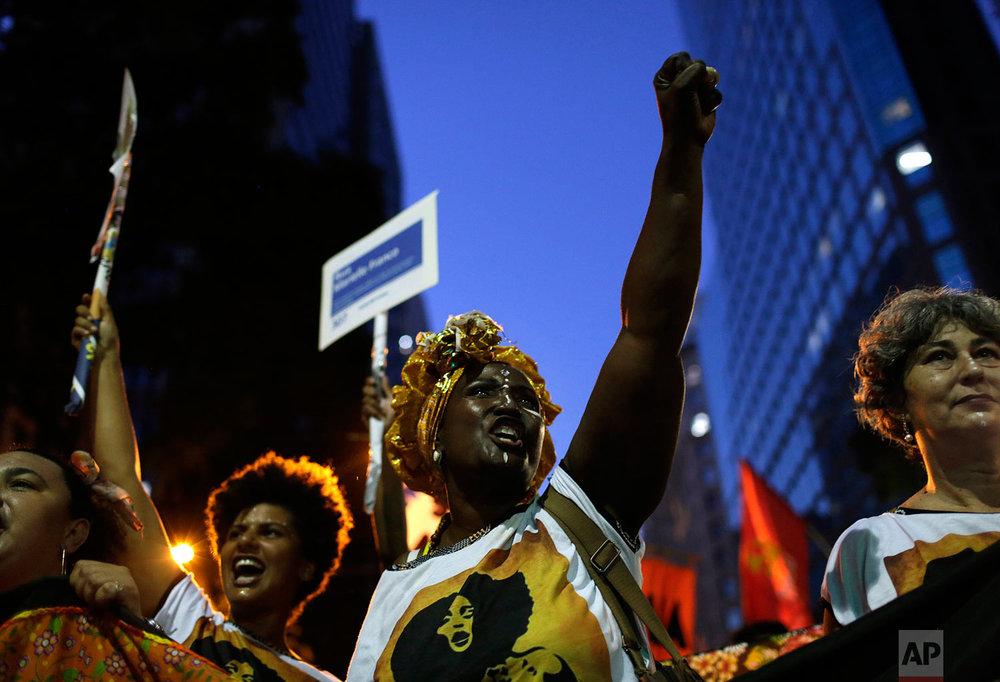 In this March 8, 2019 photo, women shout slogans during a march marking International Women's Day in Rio de Janeiro, Brazil. (AP Photo/Silvia Izquierdo)