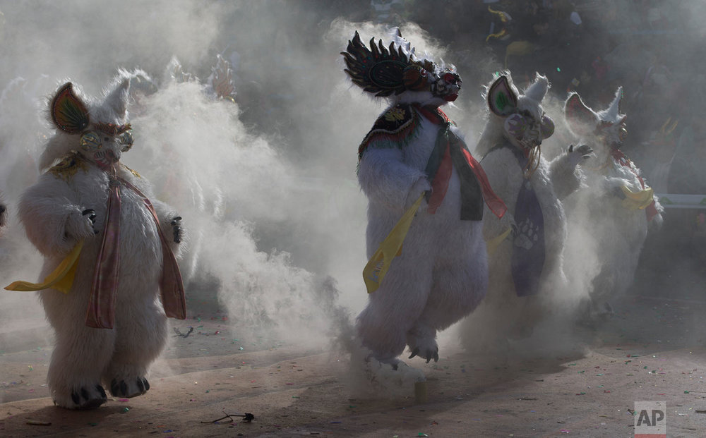 """In this March 2, 2019 photo, dancers perform the traditional """"Diablada,"""" or Dance of the Devils, during carnival celebrations in Oruro, Bolivia. (AP Photo/Juan Karita)"""