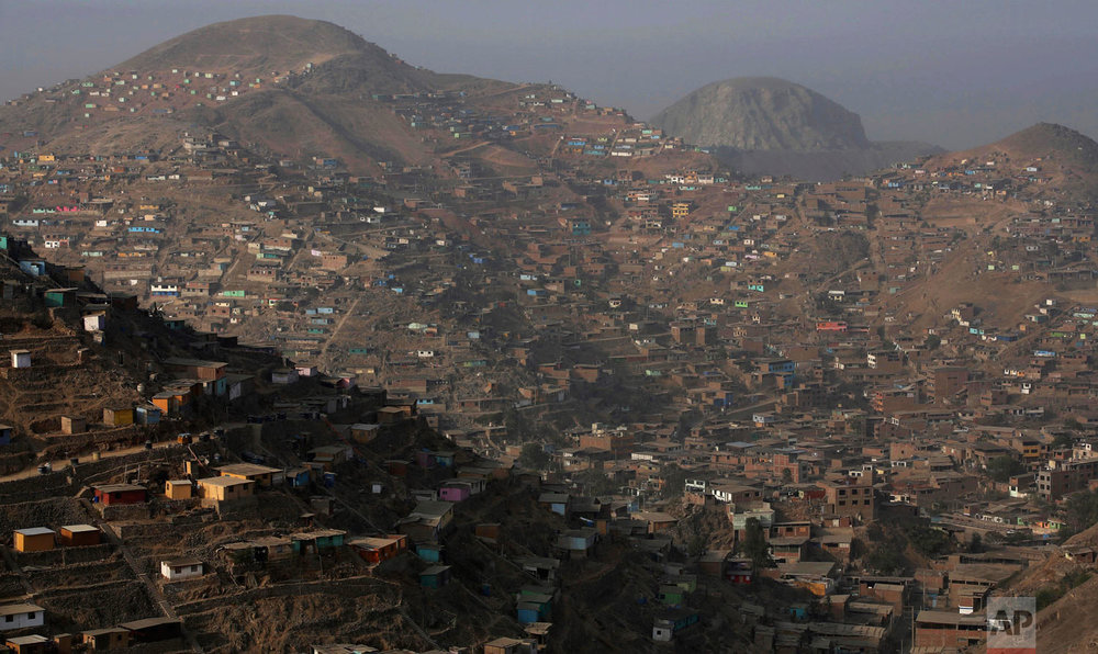 In this March 21, 2019 photo, homes fill the hillside in the arid Nueva Esperanza shantytown of Lima, Peru. Residents here pay about $1.50 dollars per 50 liter container which is filled by a water truck service that passes daily. World Water Day will be marked on Friday, March 22, 2019. (AP Photo/Martin Mejia)