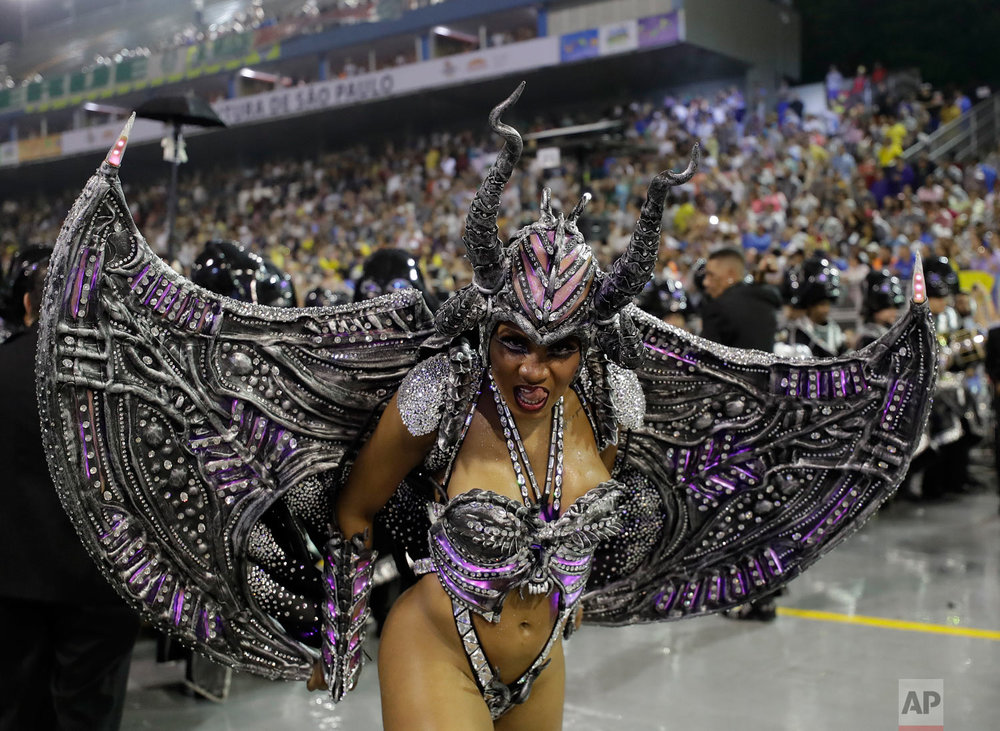In this March 2, 2019 photo, a dancer from the Imperio de Casa Verde samba school performs during a carnival parade in Sao Paulo, Brazil. (AP Photo/Andre Penner)