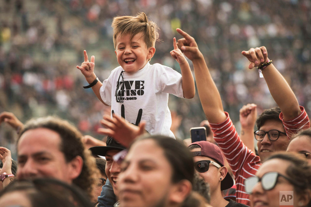 In this March 17, 2019 photo, a youth attends the Vive Latino music festival in Mexico City. The two-day rock festival is one of the most important and longest running of Mexico. (AP Photo/Christian Palma)