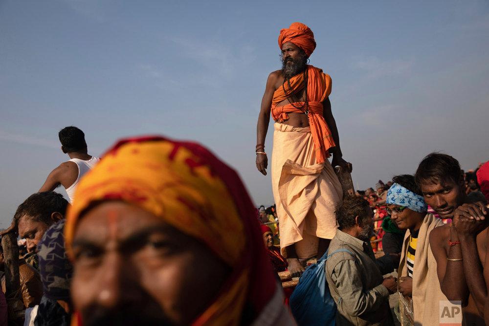 Hindus gather for a spiritual cleansing dip at Sangam, the confluence of the rivers Ganges, Yamuna and mythical Saraswati, during the Kumbh Mela festival in Prayagraj, India on Jan. 15, 2019. (AP Photo/Bernat Armangue)