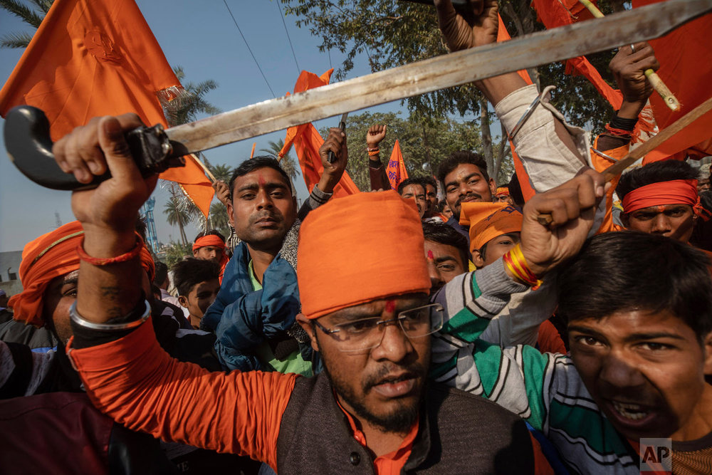Hindu hardliners, one holding a sword, chant slogans against Muslim communities Nov. 25, 2018, during a rally demanding a Hindu temple be built on a site in northern India where hardliners in 1992 had attacked and demolished a 16th century mosque in Ayodhya Uttar Pradesh. Riots had left about 2,000 people dead. (AP Photo/Bernat Armangue)