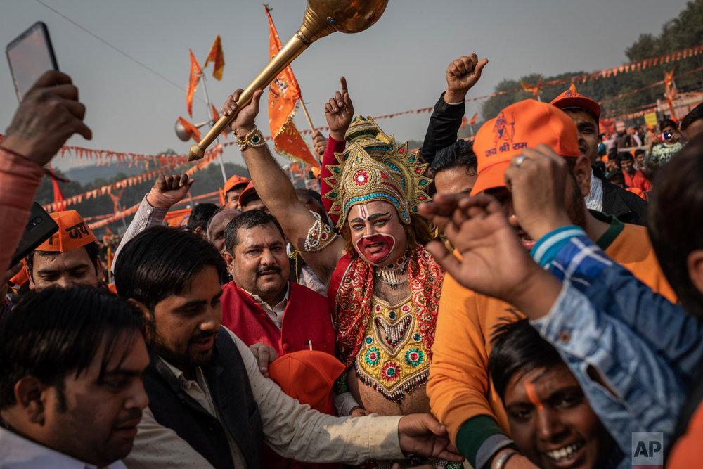 A supporter of the Hindu nationalist political group Vishwa Hindu Parishad is dressed as the Hindu deity Hanuman during a rally in New Delhi, India, Dec. 9, 2018. (AP Photo/Bernat Armangue)