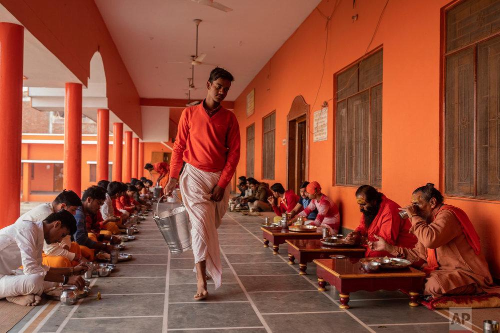 Hindu students of the Baghambari Math Gaddi have lunch in Prayagraj, India, Dec. 12, 2018. (AP Photo/Bernat Armangue)
