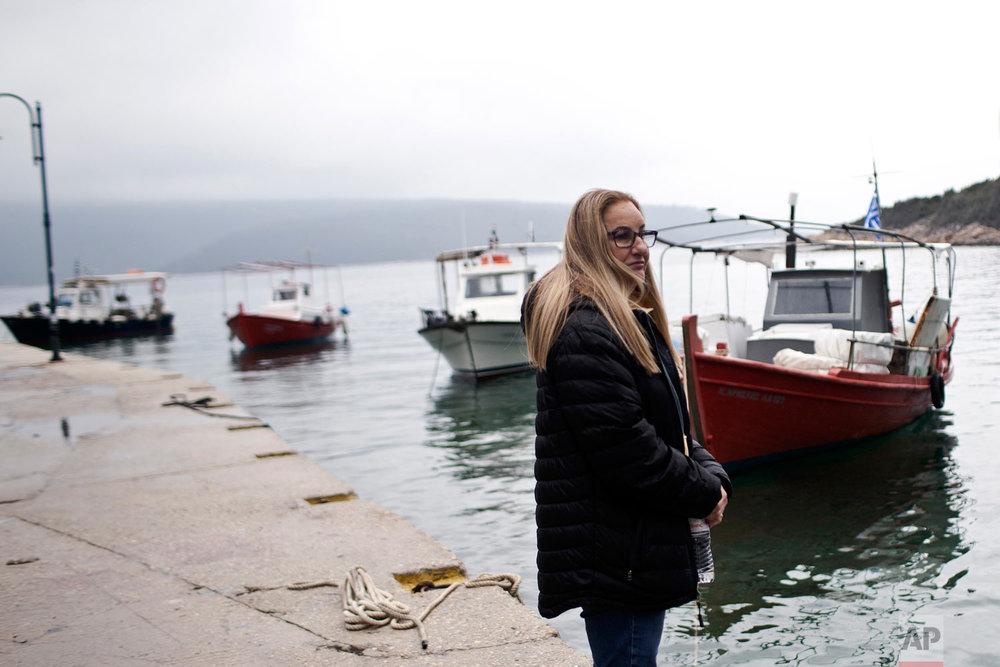 Archaeologist Elpida Hadjidaki stands at the harbor of Steni Vala, with Peristera island seen in the background, in Greece, April 7, 2019. (AP Photo/Petros Giannakouris)
