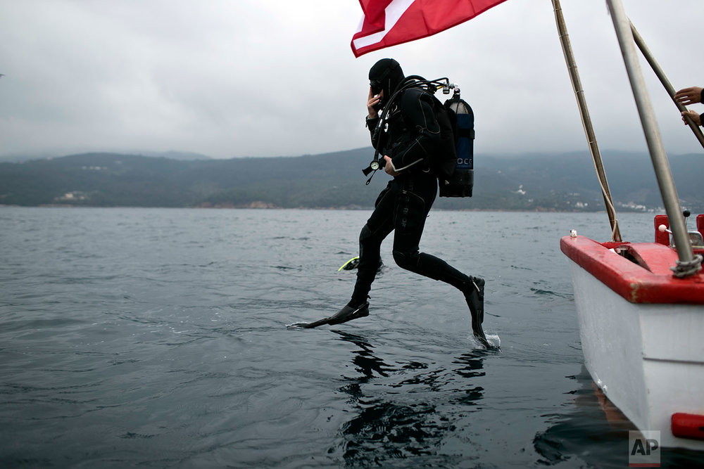 Lead archeologist for the project of opening wrecks to visitors Dimitris Kourkoumelis dives to a 5th Century B.C. shipwreck near the coast of Peristera, Greece, Sunday, April 7, 2019. (AP Photo/Petros Giannakouris)