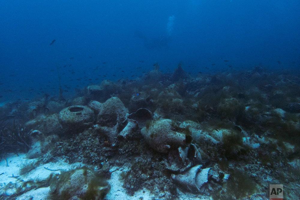Ancient amphoras lie at the bottom of the sea near the coast of Peristera, April 7, 2019. (AP Photo/Elena Becatoros)