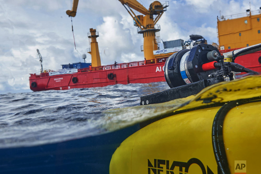 A manned submersible emerges from the water after a dive off the coast of the island of St. Joseph in the Seychelles, April 8, 2019. (AP Photo/David Keyton)