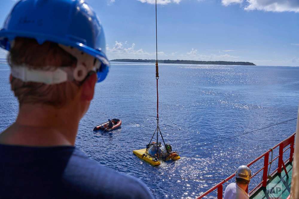 Submersibles sent to recover an ROV (Remotely Operated Vehicle) lost off the coast of the tiny island of Alphonse Seychelles, March 13, 2019. (AP Photo/David Keyton)
