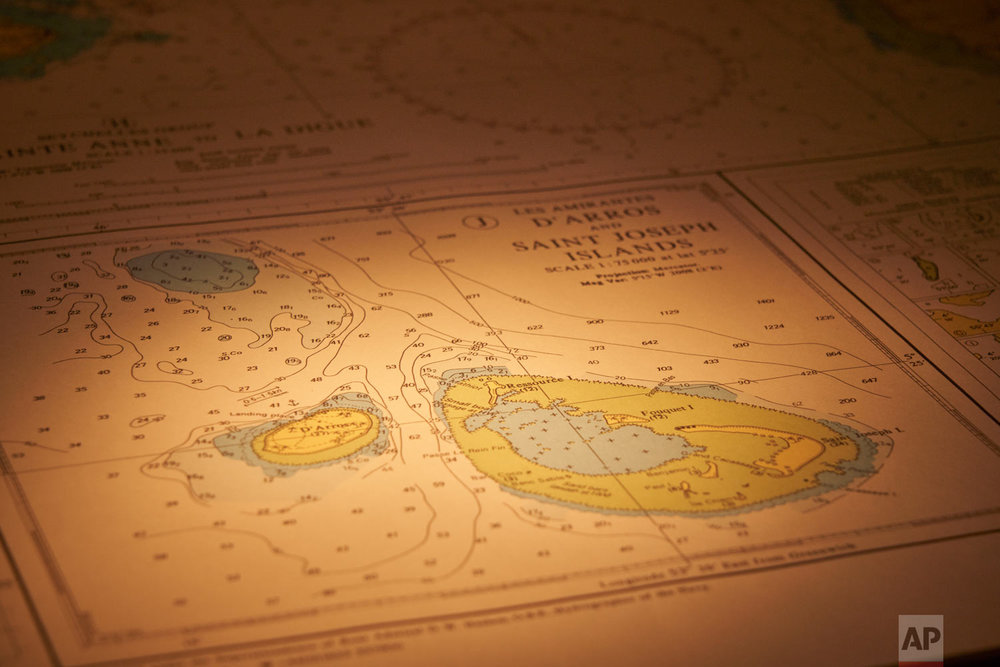 A nautical chart shows the waters around the island of Saint Joseph in the Seychelles lays open on the bridge of the Ocean Zephyr, April 11, 2019. (AP Photo/David Keyton)