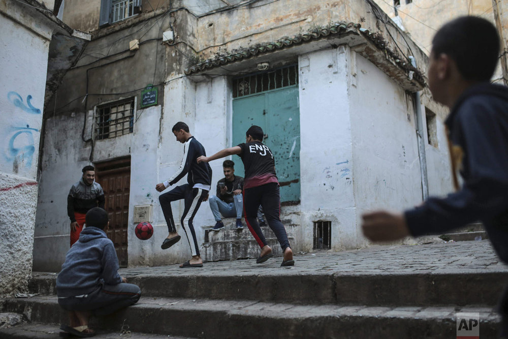 Children play football in the Kasbah, a UNESCO world heritage site, in Algiers, Algeria, on Thursday, April 11, 2019. (AP Photo/Mosa'ab Elshamy)