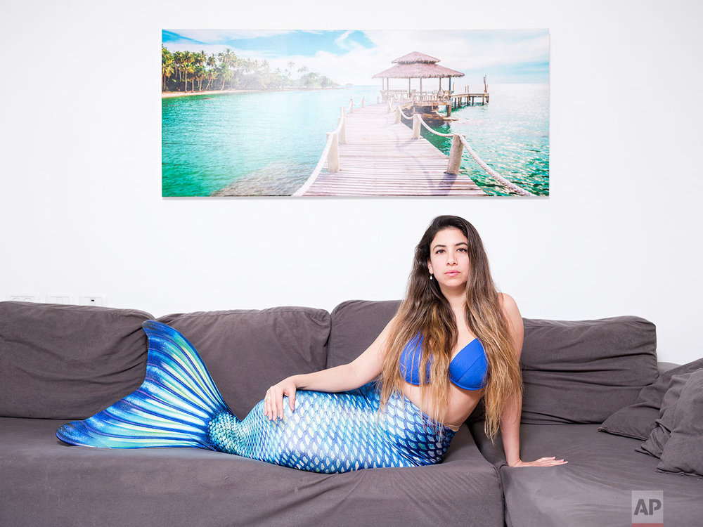 In this Monday, March. 4, 2019 photo, Ligal Shternhell, a member of the Israeli Mermaid Community, poses for a portrait as she wears a mermaid tail at her home in Kibbutz Ein Carmel, Israel. (AP Photo/Oded Balilty)