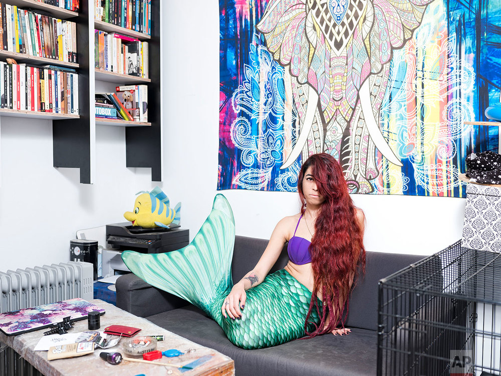 In this Sunday, Feb. 24, 2019 photo, May Lighty Cohen, a member of the Israeli Mermaid Community, poses for a portrait as she wears a mermaid tail at her home in Herzliya, Israel. (AP Photo/Oded Balilty)