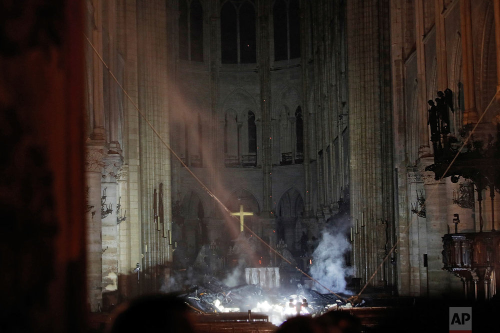Smoke fills the interior of Notre Dame Cathedral in Paris, Monday, April 15, 2019. (Philippe Wojazer/Pool via AP)