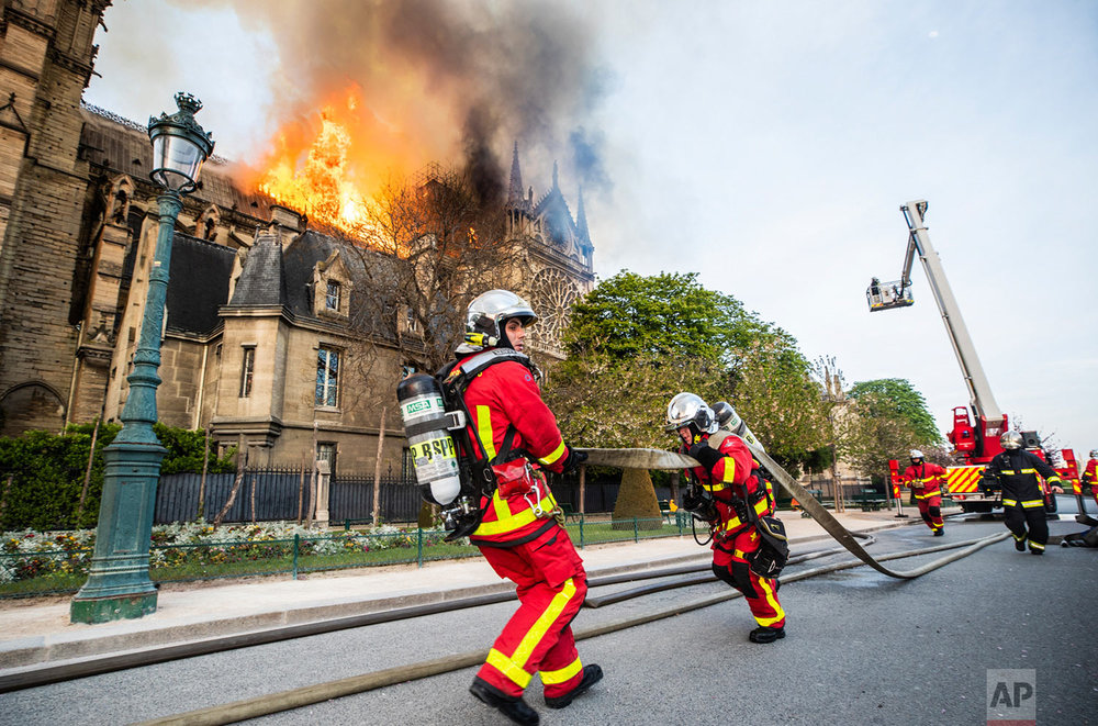 In this photo provided by the Paris Fire Brigade, firefighters work at the burning Notre Dame Cathedral, April 15, 2019. (Benoit Moser, BSPP via AP)