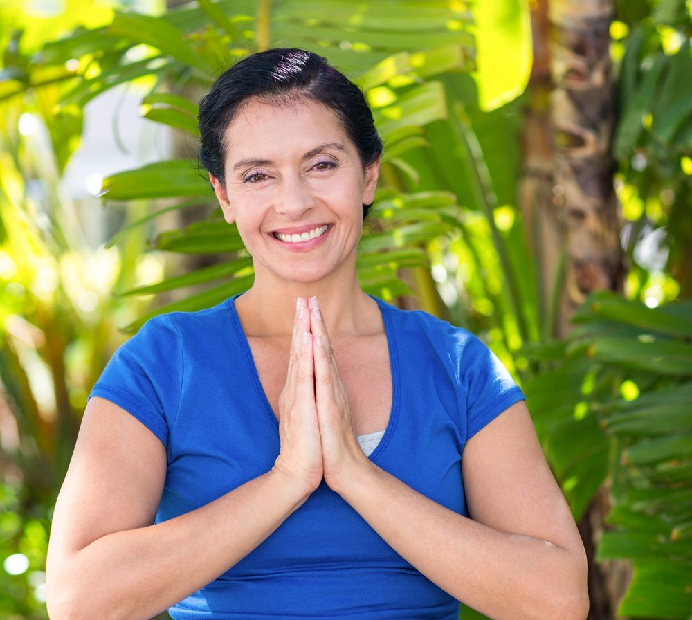 bigstock-Smiling-woman-doing-yoga-on-a--88496777.jpg