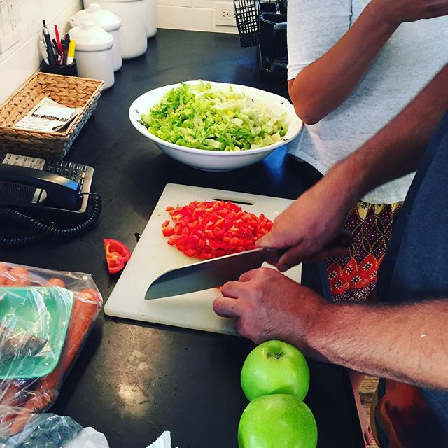 Hard at work preparing our kale and romaine salad. Full recipe coming soon on olivianapoli.com. Link in profile. #kale #romaine #greenapples #peppers #healthy #salad #healthysalads