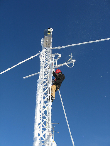 A Summit Station Staffer does regular maintenance on the Flux Tower.
