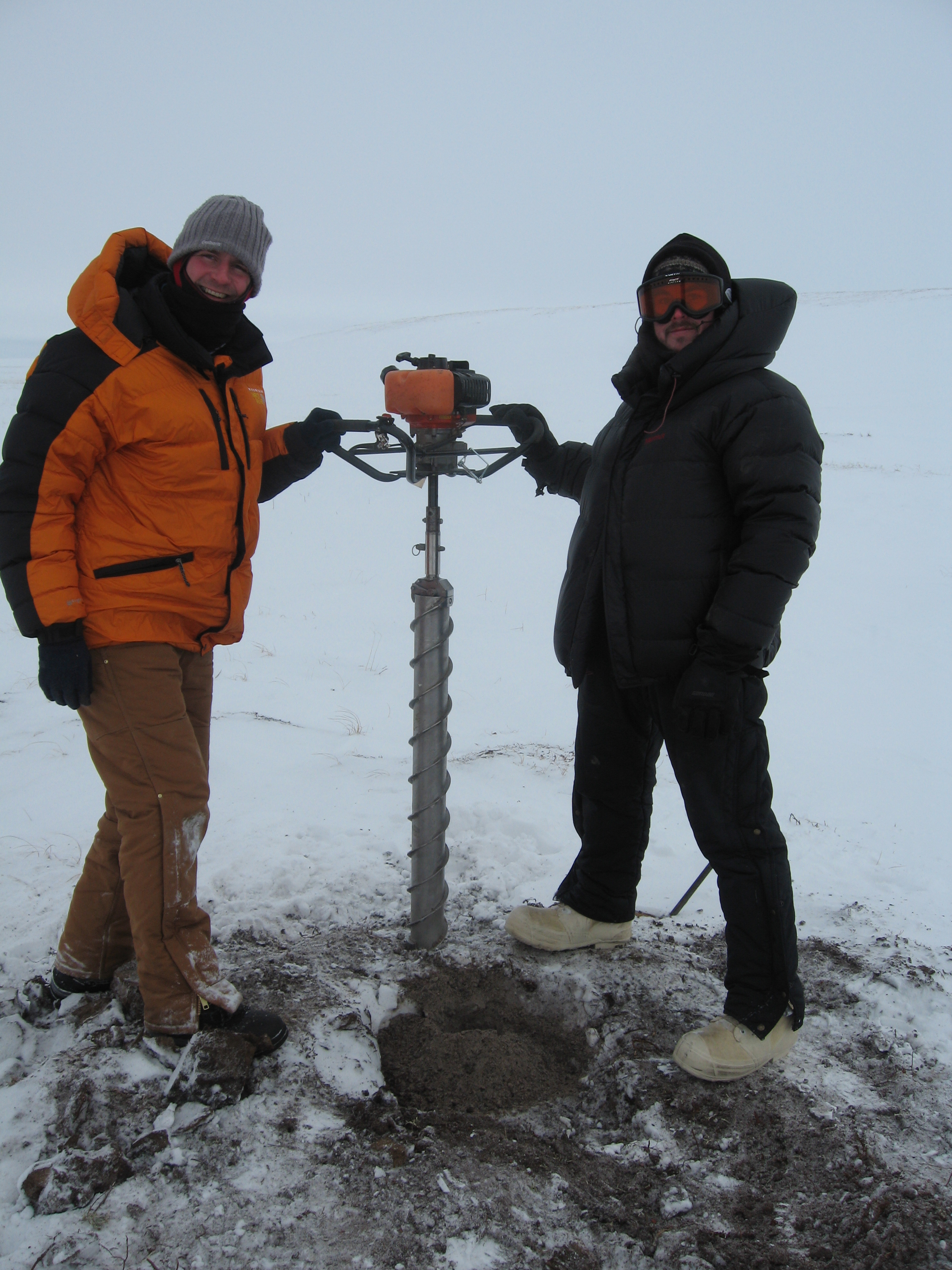 Guido Grosse (left) and Ben Jones take a break from extracting sediment cores as part of the Walter research project.