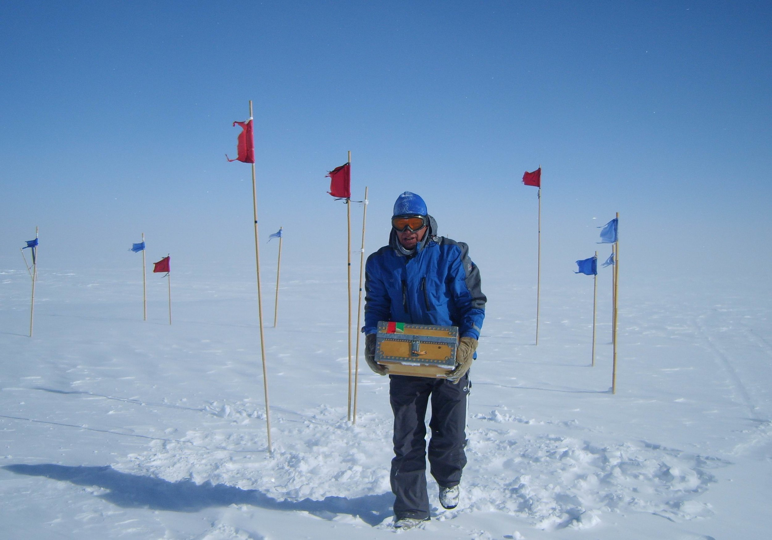 The Meijer team harvested shallow ice cores to about two meters depth from an isotopically enriched site (seen here within the flag border) near Summit Station. They also conducted maintenance on dataloggers at the site.