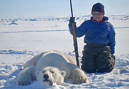 Brad and his first polar bear kill. Courtesy www.polarhusky.com