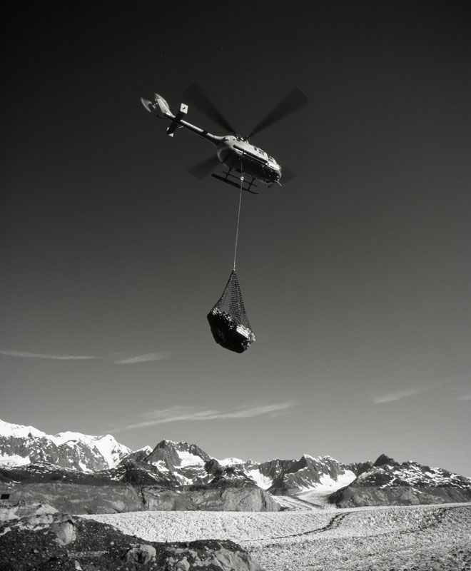 Helicopter pilot Jim Harvey (Air Logistics) moving sling loads at Columbia Glacier, June 2004